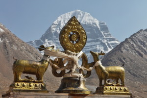 Buddhist statues in Tibet with holy Mount Kailash background